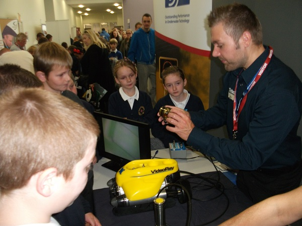 Tritech's Production Manager, Darren Brackwell describes Tritech products to intrigued younsters.
